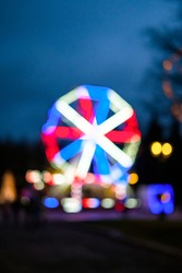 Abstract blurry red, blue and white ferris wheel in cross patter