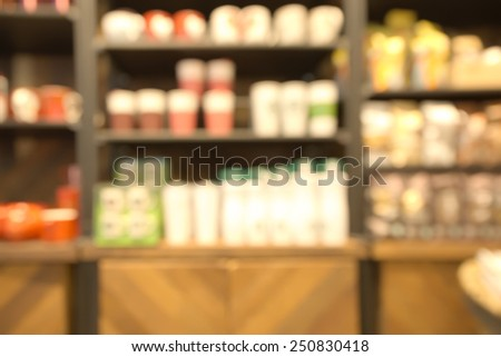 Abstract blurry retail store water glass shelf background