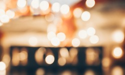 Abstract bokeh background. Christmas Glittering background with the word HOUSE. Warmth, coziness. Blurred background with bookeh.