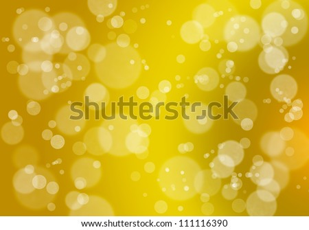 Abstract bokeh background in golden colors - stock photo
