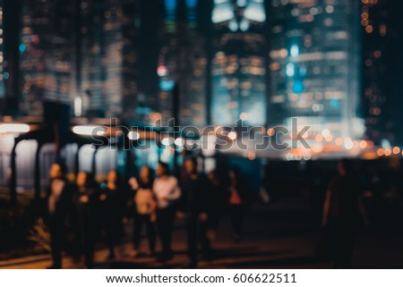 Abstract bokeh background of people walk at the park on night