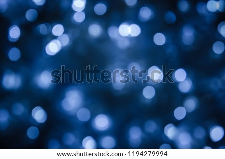 Abstract bokeh festoon on dark blue background #1194279994