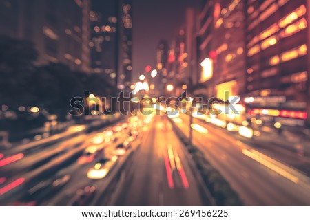 Abstract bokeh light background of city night with vignette vintage color tone tuned