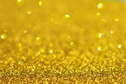 Abstract bokeh lights  glittering gold colors blur background