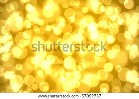 abstract bokeh lights on golden colored background stock photo