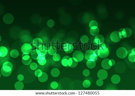 abstract bokeh lights on green background