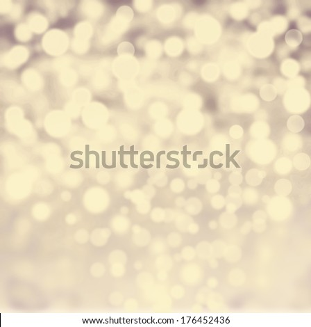 Abstract bokeh lights vintage background with defocused golden lights. De focussed background with sparkles, fine art, soft focus, greeting holiday card, festive frame, magic lights, shiny wallpaper