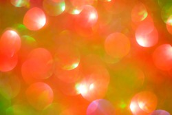 Abstract bokeh multi colors sparkles, Festive Christmas sparkling lights bokeh background. Yellow, orange, red and green.
