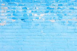 Abstract Brickwall Background Texture. Old brick wall painted blue with peeling paint. Creative Christmas Background. Grunge Wallpaper or Web banner With Copy Space For design.