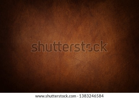 Photo of  Abstract brown leather texture may used as background.