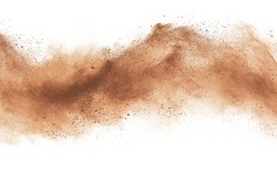 Abstract brown powder explosion. Closeup of brown dust particle splash isolated on white background