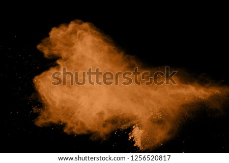 abstract brown powder splatted background. Colorful powder explosion on black background. Colored cloud. Colorful dust explode. Paint Holi. #1256520817
