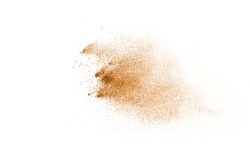 Abstract brown powder splatted on white background.