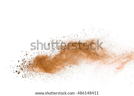 Stock Photo abstract brown powder splatted on white background