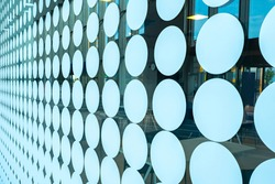 Abstract business background. Glass facade with round stickers. Restaurant showcase with round stickers. Texture on theme of business. Background with geometric elements. Glass pattern.