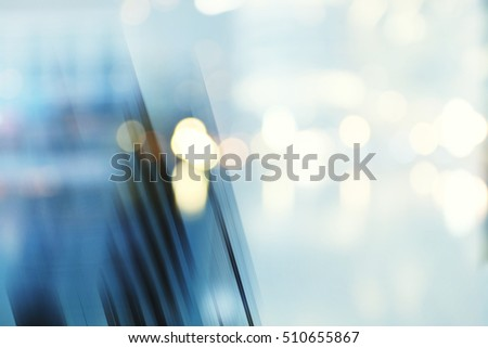 Abstract business modern city urban futuristic architecture background. Real estate concept, motion blur, reflection in glass of high rise skyscraper facade, toned blue picture with bokeh #510655867