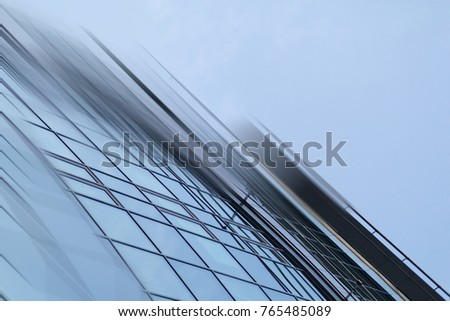 Abstract business modern city urban futuristic architecture background. Real estate concept, motion blur, reflection in glass of high rise skyscraper facade, toned blue picture with bokeh #765485089
