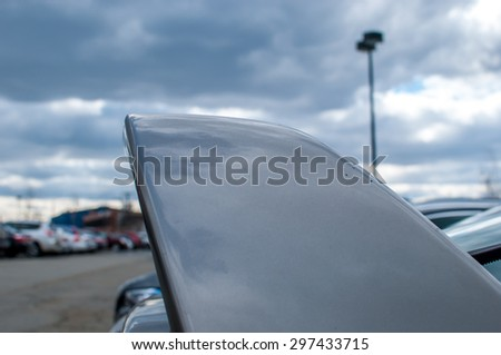 Abstract car fin with cloudy sky background. Flying through the sky. Abstract industrial park.  Parking lot. Car parking area. Car trunk abstract.