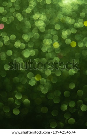 Abstract celebrate, twinkled bright bokeh defocused and sparkles background. Greeting card or invitation. Sparkling Lights Festive background. layer of special effects for different types of blending. #1394254574