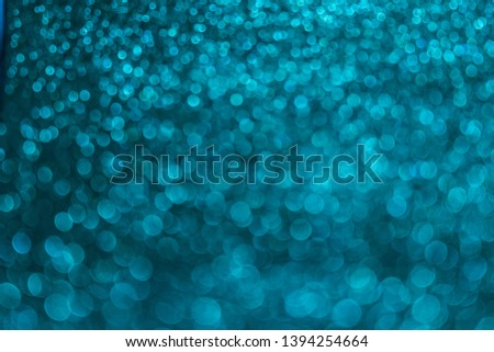 Abstract celebrate, twinkled bright bokeh defocused and sparkles background. Greeting card or invitation. Sparkling Lights Festive background. layer of special effects for different types of blending. #1394254664