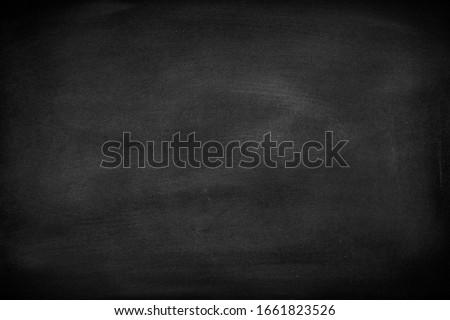 Abstract Chalk rubbed out on blackboard or chalkboard texture. clean school board for background or copy space for add text message. Backdrop of Education concepts.