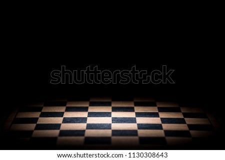 abstract chessboard on dark background lighted with snoot #1130308643