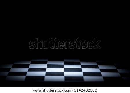 abstract chessboard on dark background lighted with snoot #1142482382