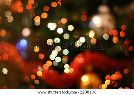 Abstract christmas background, light blur creating nice bokeh, red white and orange