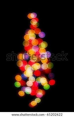 Abstract Christmas tree - Christmas lights on a Christmas tree out of focus.