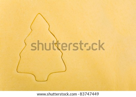 Abstract christmas tree on raw cookie dough