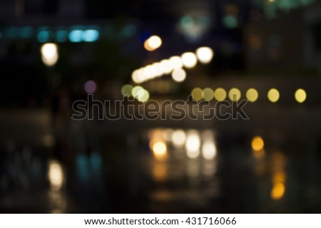 Abstract circular bokeh lighting in the night can be used for background and text input.