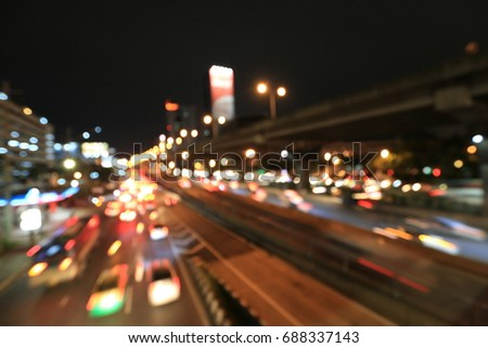 Abstract circular bokeh motion lens blur backround of city and street light at blue night time in Thailand. #688337143