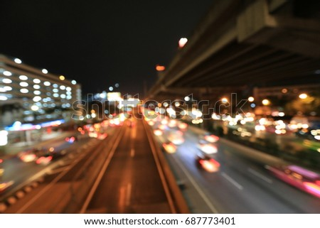 Abstract circular bokeh motion lens blur backround of city and street light or Bokeh light from car in street in night time. Bangkok Expressway Thailand. #687773401