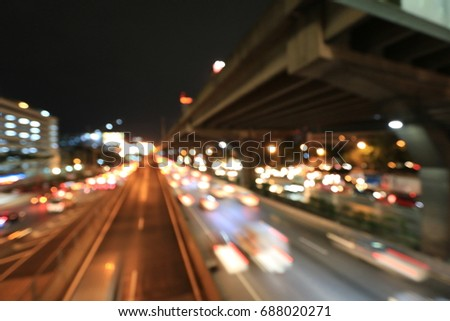 Abstract circular bokeh motion lens blur backround of city and street light or Bokeh light from car in street in night time. Bangkok Expressway Thailand. #688020271