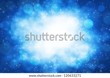 Abstract circular bokeh with blue background.