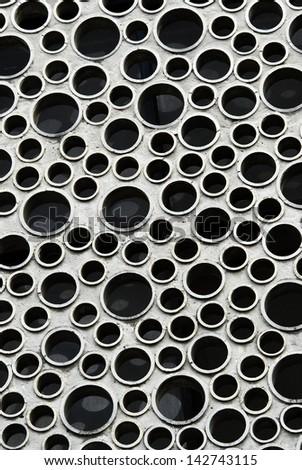Abstract circular holes in the wall