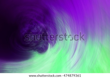 Abstract circular motion blurred background in purple,cyan,green