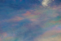 Abstract Cirrocumulus or rainbow cloud on blue sky in sunset time background.