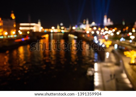 Abstract city lights background. Defocused urban background at night. Bokeh multicolored #1391359904