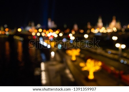 Abstract city lights background. Defocused urban background at night. Bokeh multicolored #1391359907