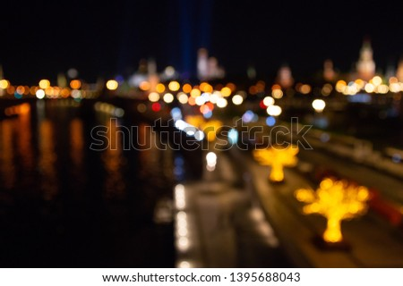 Abstract city lights background. Defocused urban background at night. Bokeh multicolored #1395688043