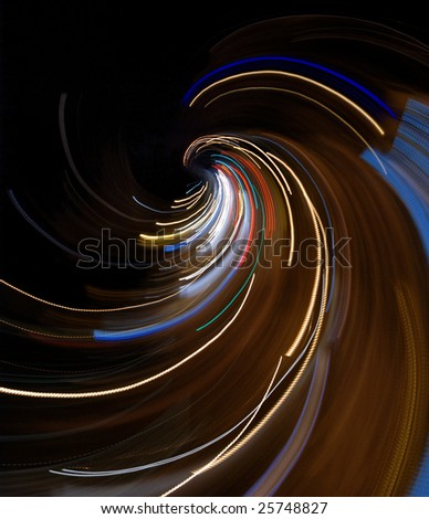 Abstract city lights composition: taken from aerial view of a night crossroad by fast camera movement.