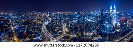 Abstract City scape and network icon connection concept of Kuala Lumpur City center at night dusk.