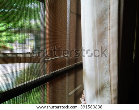 abstract close up part of wooden window and curtain with mosquito wire screen and Curved steel in house #391580638
