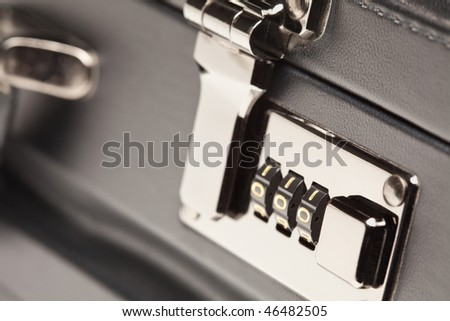 Abstract Close Up Shot of a Black Leather Briefcase Latch and Lock.