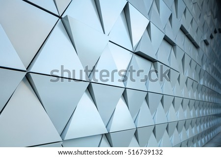 Abstract close-up view of modern aluminum ventilated triangles on facade  #516739132