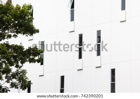 Abstract close-up view of the random narrow window with concrete wall on facade. #742390201