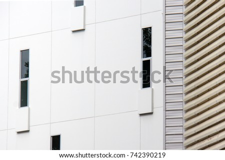 Abstract close-up view of the random narrow window with concrete wall on facade. #742390219