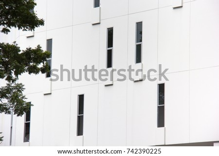 Abstract close-up view of the random narrow window with concrete wall on facade. #742390225