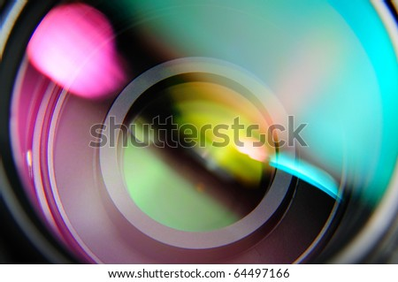 abstract closeup front of lens with pink and turquoise reflection